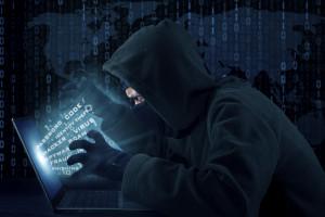 Portrait of male hacker wearing black mask and stealing user identity